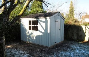 A traditional garden shed from our range of national trust garden sheds and summerhouses. The building has rustic, vertically-sawn cladding and a corrugated roof with single access door. Other charming features include cast iron door furniture.