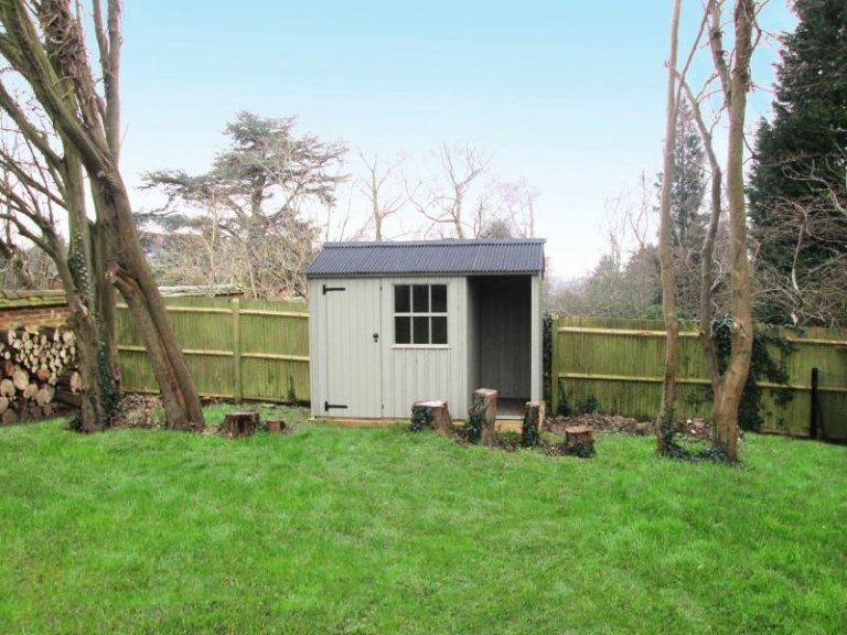 This traditional garden shed is from our national trust range of sheds and summerhouses and has a built in logstore. The shed has an apex roof covered with our corrugated material and is painted in the national trust shade of disraeli green.