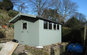 A spacious and functional timber garden shed with insulation and electrics. It has shiplap cladding and an apex roof covered with heavy-duty felt. The exterior is painted in the shade of Lizard.