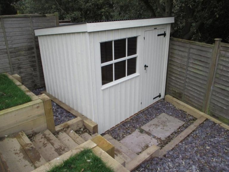 A compact and convenient garden shed from our range of national trust sheds and summerhouses with vertical cladding and georgian window.