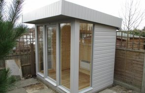 A moderna dn stylish garden studio with electrics and heating. The timber garden building has a pent roof covered in heavy-duty felt and is painted with pebble exterior paint.