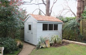High quality timber garden shed with rustic weatherboard cladding and a security pack. The wooden shed has an apex roof covered with cedar shingles and is painted in our exterior shade of Verdigris.