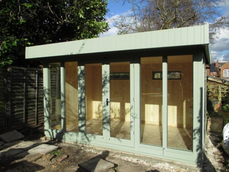 Modern and stylish garden studio with a pent roof and natural pine lining. The wooden garden building boasts floor to ceiling windows and insulation. It makes the perfect work from home office.