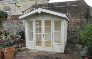 Blakeney Summerhouse with an Overhanging Apex Roof covered in Grey Slate Effect Tiles