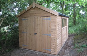 A light oak preservative stained Superior Shed with windows in the length, double doors in the gable and a heavy duty felted roof