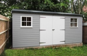 An attractive superior timber garden shed with double doors and a two-tone paint style. The wooden garden shed features an apex roof covered in heavy-duty heat-bonded felt