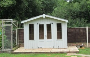 A traditional and rustic summerhouse from the national trust range of sheds and summerhouses. The Ickworth wooden summerhouse boasts cast iron door furniture, leaded windows and an apex roof covered with corrugated material.