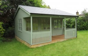 A stylish and traditional garden room with veranda and decking. The timber garden building boasts a large interior with electrics, lining, insulation and painted walls. The windows feature attractive georgian bars and the roof is covered with grey slate composite tiles.
