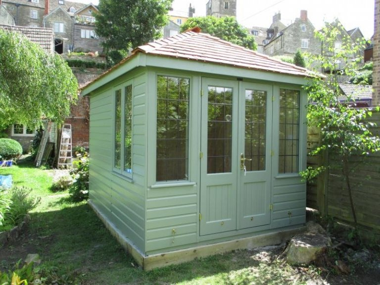 A traditional and attractive summerhouse with leaded windows and smooth shiplap cladding. The cley summerhouse features double entrance doors and windows on the gable end of the building and boasts an exterior painted in the opaque paint shade of lizard.
