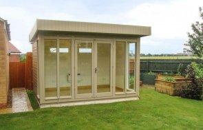 Attractive wooden garden studio. Modern timber garden studio office with floor to ceiling windows