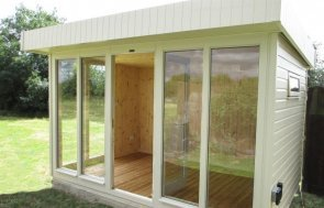 A modern garden studio with full length window and natural internal lining. The studio has an electric pack installed so that lighting and appliances can be used