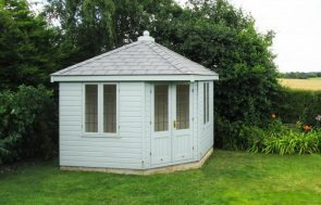 an attractive corner summerhouse with a slate roof and leaded windows. The summerhouse has double doors and is hand-made from timber at our Norfolk factory using expert craftsmanship,