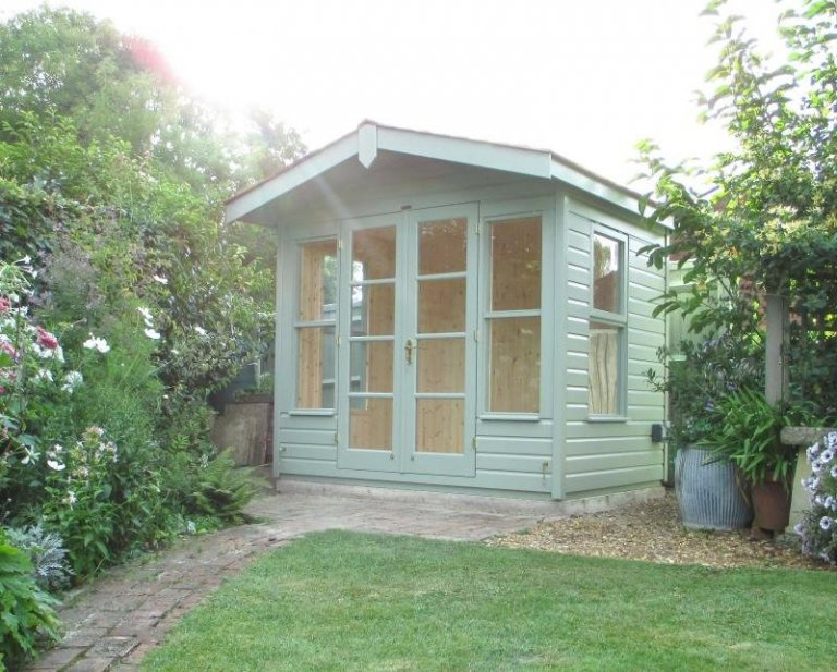 An attractive timber garden building with apex roof and double doors. A chalet style summerhouse with smooth shiplap cladding and a natural pine interior.