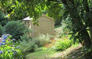 An attractive and traditional garden shed with natural wood exterior and double doors leading to the interior. It has an apex roof covered with heavy duty heat bonded felt.