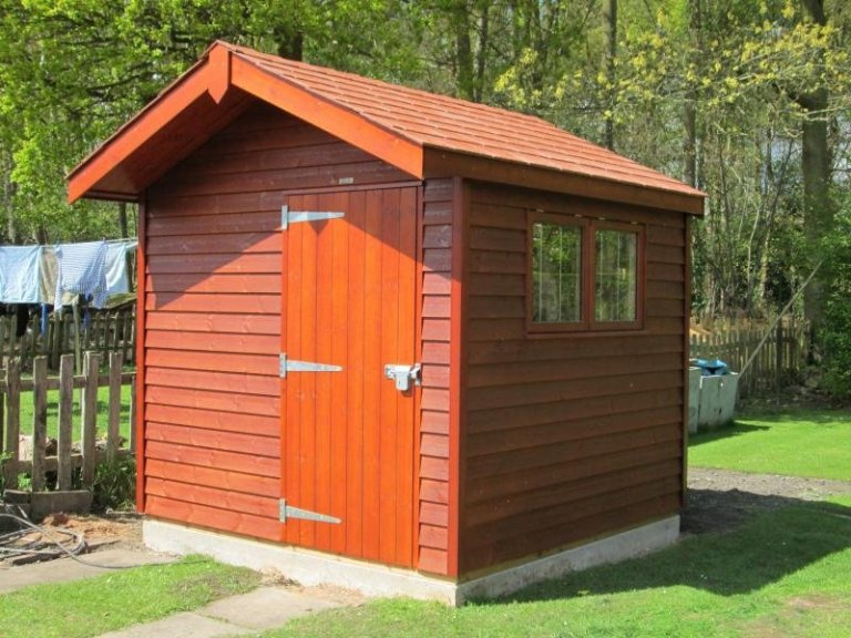 This superior shed is made with timber and has an apex roof covered with red slate tiles and rustic weatherboard cladding. The timber garden shed has enhanced security thanks to our security pack.