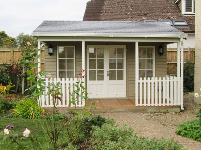 Large garden room with veranda, insulation and electrics. The garden building has an apex slate roof and attractive georgian windows with a stylish deck to sit on and enjoy the view.