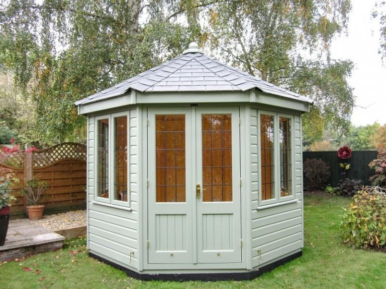 Fully insulated octagonal summerhouse with slate composite roof and finial. The windows are double glazed and leaded and the summerhouse is clad with smooth shiplap painted in the shade of Lizard.