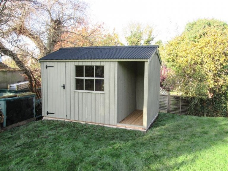 A Blickling National Trust Garden Shed with Logstore painted in the colour Disraeli Green