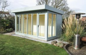 A contemporary garden studio with a pent roof and fully-glazed windows for an abundance of natural light. The building is insulated and lined with painted lining in the airy shade of ivory.