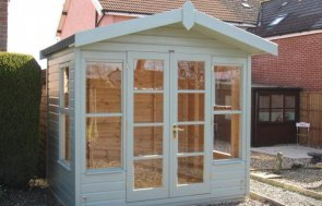 Traditional chalet-style summerhouse with shiplap cladding and fully-glazed double doors and windows. The summerhouse has a small overhang on the apex roof and an unlined interior.