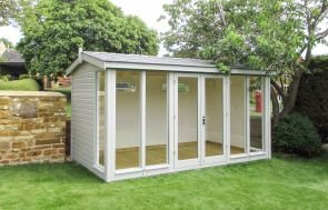 A beautiful garden studio with seven fully-glazed windows and an apex roof covered in slate-composite tiles. The interior is visible through the windows and features painted lining and a lacquered floor.