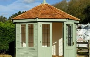 Wiveton Summerhouse in Exterior Paint System Lizard with Leaded Windows and Cedar Shingle roof tiles