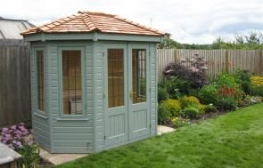 Small 1.8 x 2.5m Wiveton Summerhouse painted in Sage with Leaded Windows