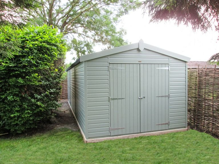 3.0 x 7.8m Superior Shed painted in Sage with an Apex Roof and Double Doors