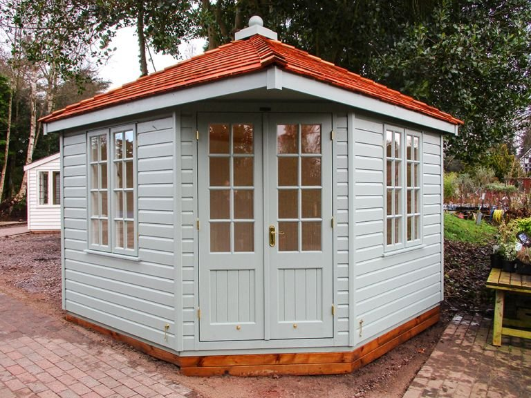 Weybourne Summerhouse in Exterior Paint System Sage Paint with Cedar Shingles on the roof and Georgian Windows