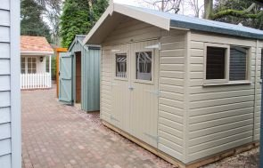 3.0 x 3.6m Superior Shed Painted in Taupe with an Overhanging Apex Roof