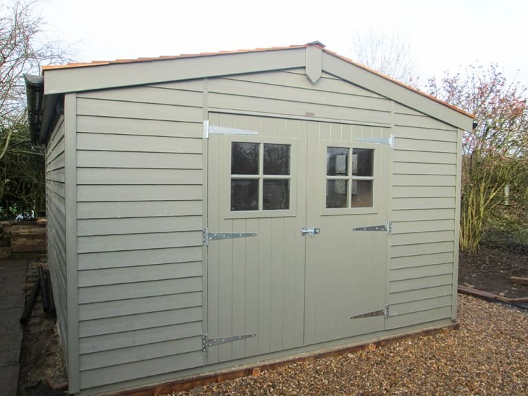 3.6 x 4.8m Superior Shed with weatherboard cladding painted in Ash from our exterior paint system, an apex roof covered in our Cedar Shingles and double glazed Georgian windows