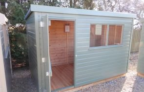 A Classic Shed painted in the colour Moss with a pent roof covered in our heavy duty roofing felt