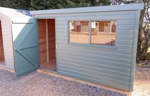 1.8 x 3.0 Classic Shed painted in the colour Moss with a pent roof covered in our heavy duty roofing felt
