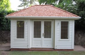 A medium-sized garden building with inset doors and cor