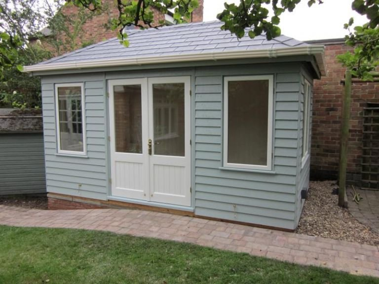 Garden Room with a hipped roof covered in slate-grey-composite-tiles and with guttering along the fascia boards.