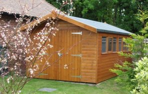 Superior Garden Shed featuring smooth shiplap cladding and an apex roof covered with heavy-duty felt. The exterior is painted in teak.