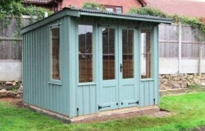 A medium sized national trust flatford summerhouse that features a pent roof covered in dark corrugated material and has vertical rustic cut cladding for a traditional aesthetic.