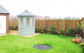 1.8  x 1.8m Wiveton Summerhouse painted in Lizard with Leaded Windows and Grey Slate Effect Roof Tiles