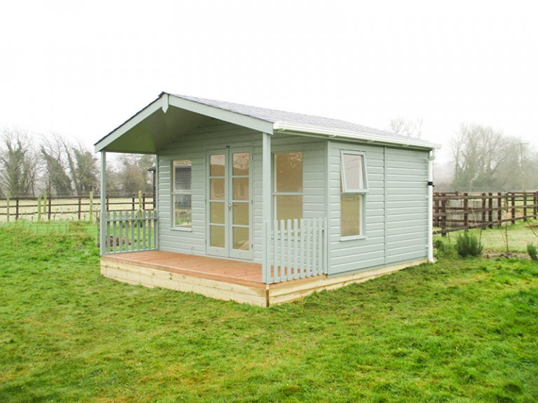 4.2 x 4.2m Morston Summerhouse with Veranda painted in Sage from our Exterior Paint System