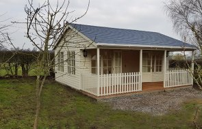 6.0 x 6.0m Garden Room with Veranda in Sandstone with Grey Slate Effect Tiles on the Roof
