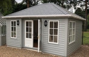Pebble Painted Garden Room measuring 3.6 x 4.8m with Weatherboard Cladding and Georgian Windows