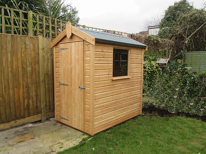 1.2 x 1.8m Classic Shed made from smooth shiplap timber cladding in Light Oak, with an apex roof covered in our heavy duty roofing felt