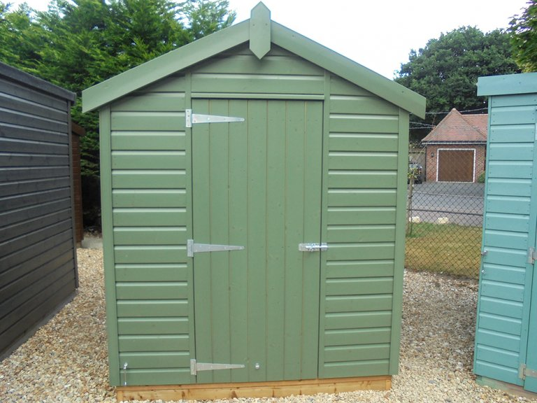 1.8 x 2.4 Classic Shed with Shiplap Cladding painted in the colour Moss
