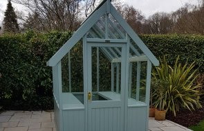 1.8 x 2.4m Greenhouse with Shiplap Cladding coated in Sage
