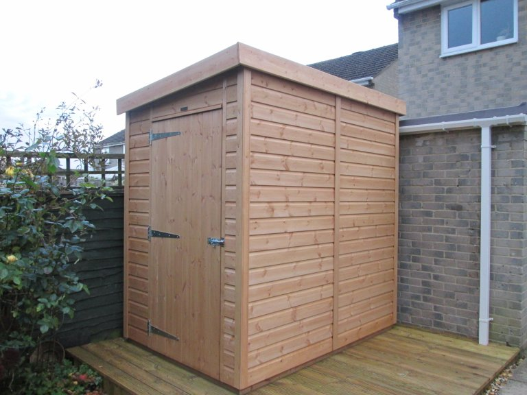 A pent roofed garden shed from our Classic Shed range, stained with a Light Oak preservative