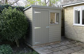 1.2 x 1.8m Classic Shed painted in the colour Stone from our exterior paint system with a pent roof