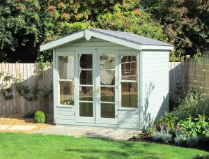 Sage painted Blakeney Summerhouse with an Overhanging Apex Roof covered in Grey Slate Effect Tiles