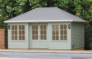 Bespoke size Garden Room in the colour sage with hipped roof covered in our grey slate effect tiles