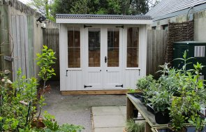1.8 x 2.4m Flatford National Trust Summerhouse with Vertically Sawn Timber Cladding painted in Earls Grey