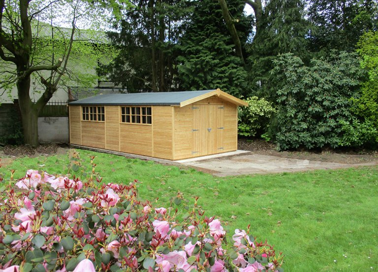 Large Superior Shed treated with a Light Oak Preservative with an Overhanging Apex Roof
